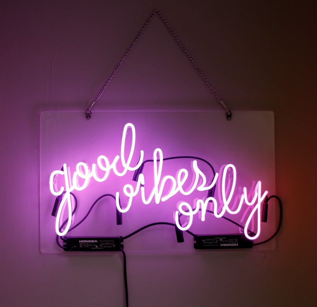 """Good vibes only"" purple neon sign"