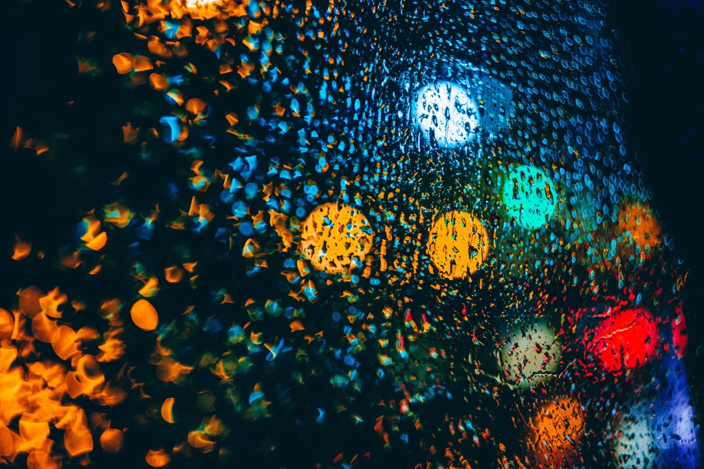 bleary lights in the rain at night