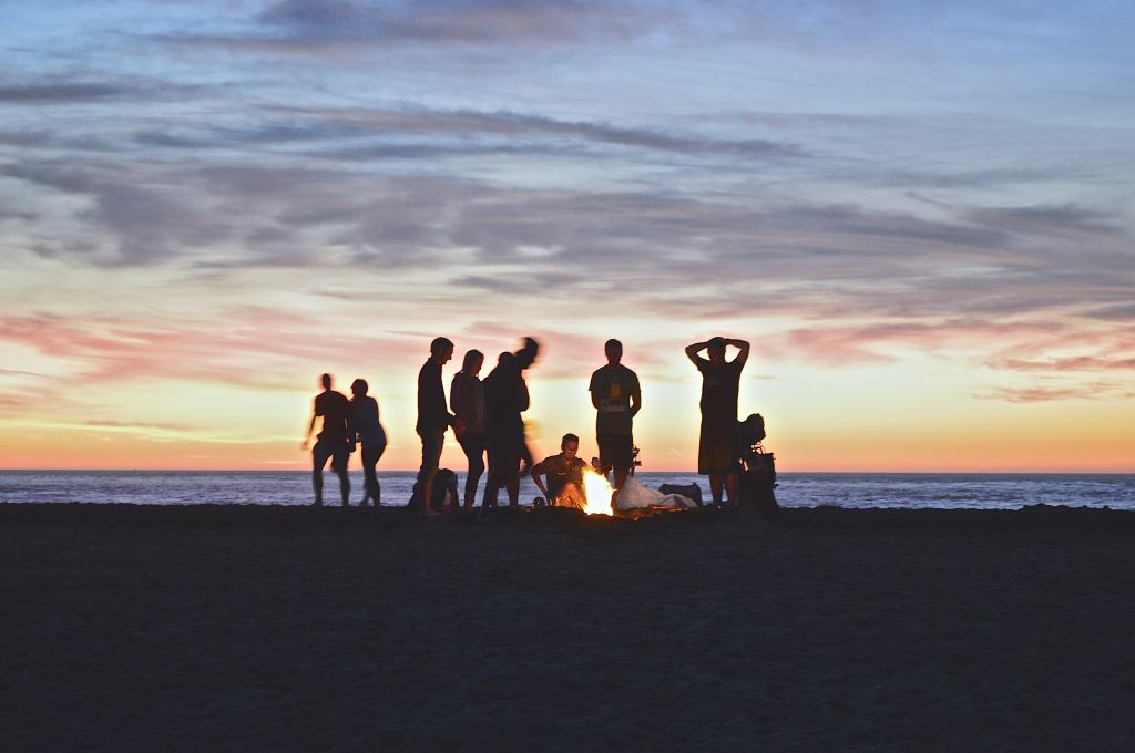 Group of people at sunset on beach