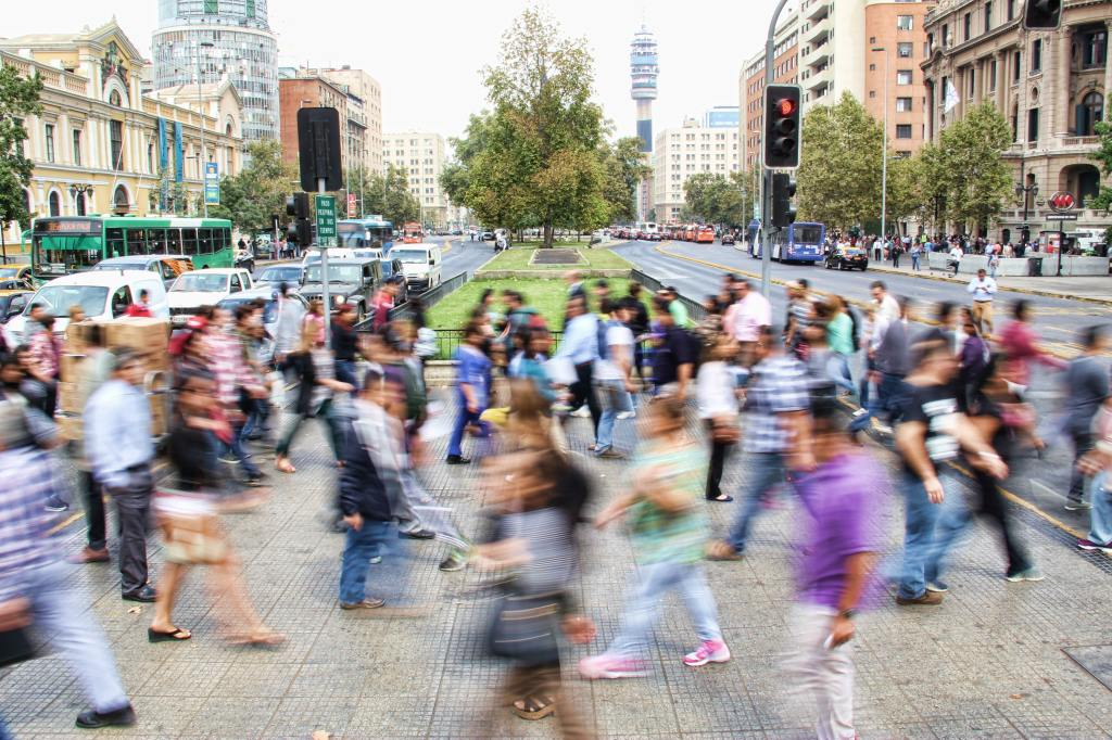 Blurry photo of people walking in a city