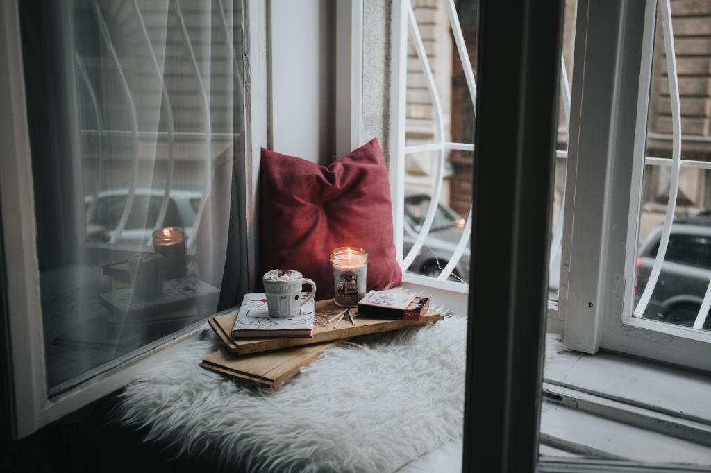 cozy reading nook with candle