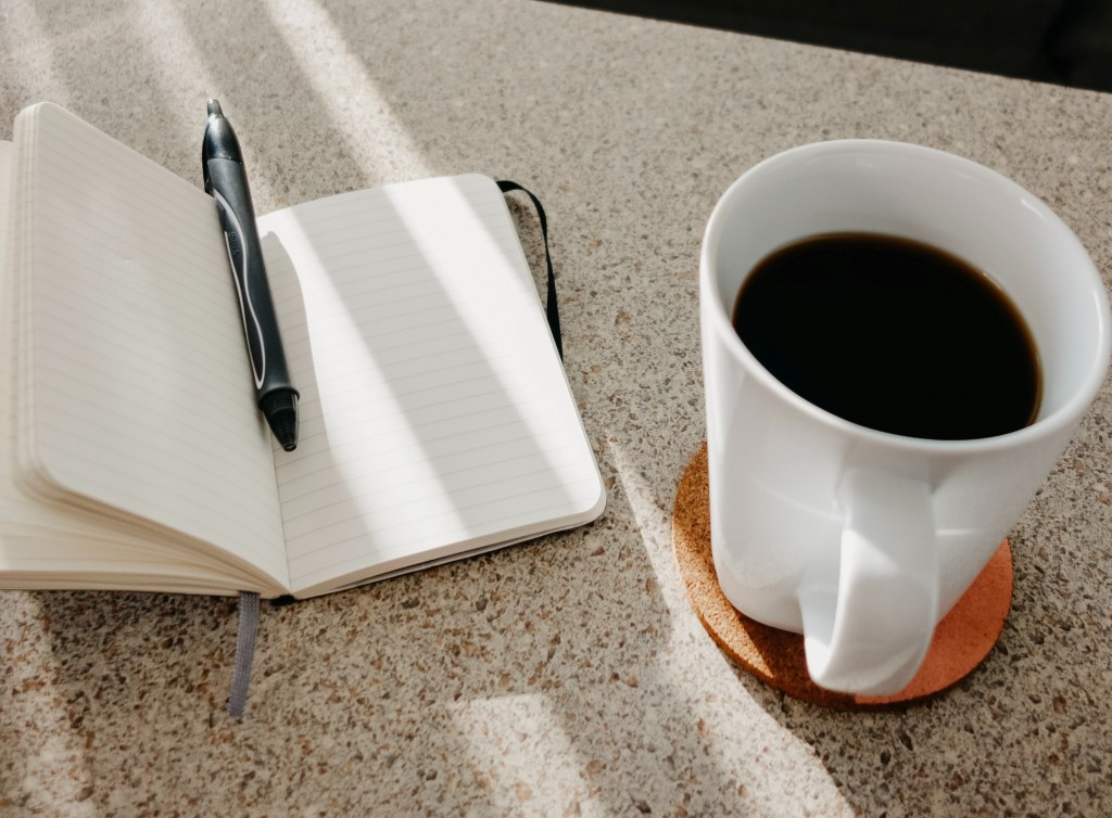 black coffee and a journal