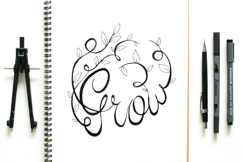 "the word ""Grow"" in cursive with leaves, surrounded by drawing tools"