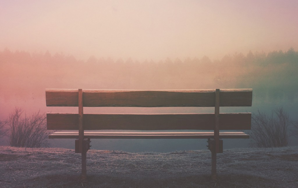 empty bench in a sunset fog