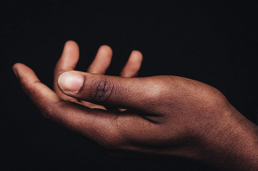 Image of a hand facing upward to help